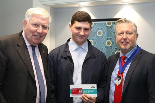 Luke Copper Solomons of Price Building Services receiving the first digital SKILLcard from Lord Martin O'Neill (left) and B&ES President Jim Marner at the Wellcome Collection in London.